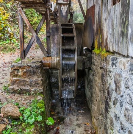 An old water wheel in a Swiss farm photo