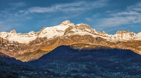 View of Aravis mountain range from Lac du Passy, France photo
