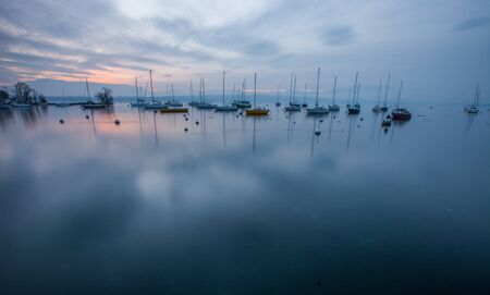 Sailboats in Lake Geneva and the morning sunrise  photo