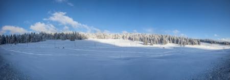 jura: Panorama view of Jura mountain range winter landscape at La Givrine, St Cergue, Switzerland