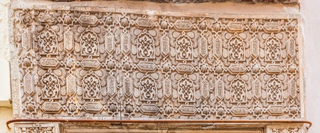 December 15th 2012. Alhambra, Granada, Spain. Arabic script carving at Nasrid Palace, Alhambra, Granada, Spain.