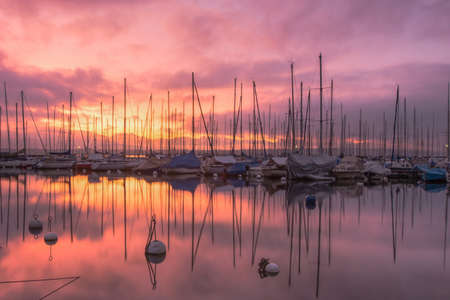 Sailboats at dawn and sunrise in Lake Geneva, Switzerland photo