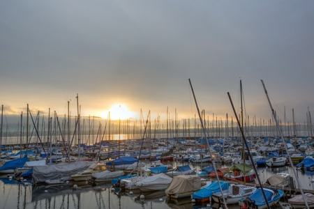 A boat marina at Versoix, Geneva, Switzerland at sunrise