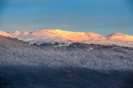 jura: Sunrise morning lights reflected on the mountain snow