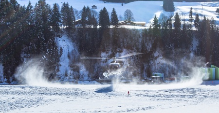 oex: Chateau de Oex, Switzerland, 26th January 2013. A helicopter landing at a snow field at the 35th International Hot Air Balloon festival. It is being held from 26th January to 3rd February 2013.