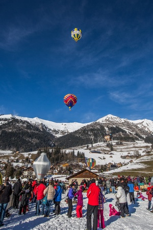 oex: Chateau de Oex, Switzerland, 26th January 2013. Crowd at the 35th International Hot Air Balloon festival. It is being held from 26th January to 3rd February 2013.