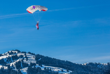 oex: Chateau de Oex, Switzerland, 26th January 2013. Parachutists at the 35th International Hot Air Balloon festival. It is being held from 26th January to 3rd February 2013.