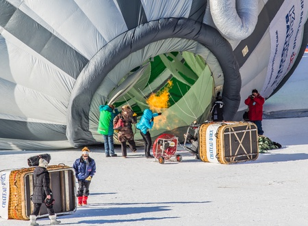 oex: Chateau de Oex, Switzerland, 26th January 2013. Ballonist preparing their hot air balloon at the 35th International Hot Air Balloon festival. It is being held from 26th January to 3rd February 2013.
