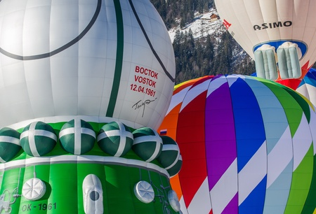 oex: Chateau de Oex, Switzerland, 26th January 2013. Hot air balloons at the 35th International Hot Air Balloon festival. It is being held from 26th January to 3rd February 2013.