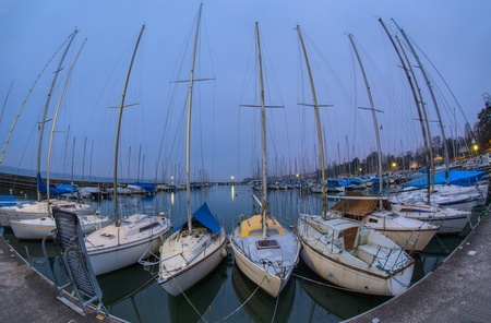 Sailboats at a marina at Lake Geneva, Switzerland photo