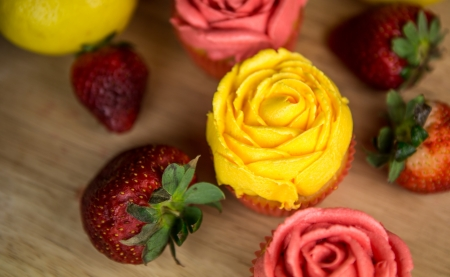 Cupcakes, lemon and strawberry on a pastry board  photo
