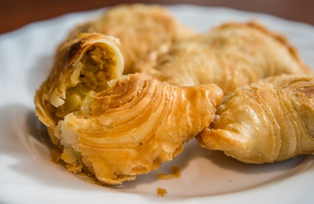 Malaysian favourite snack, curry puff on a white plate photo