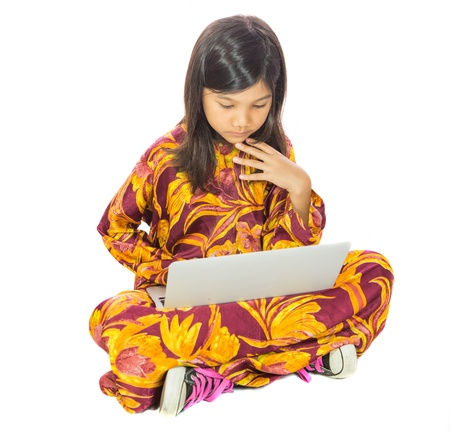 A young Malay  Asian girl using laptop photo