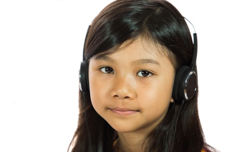 Young Malay  Asian girl listening to music with headphone photo