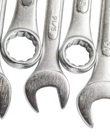 open end wrench: A set of spanners over white background