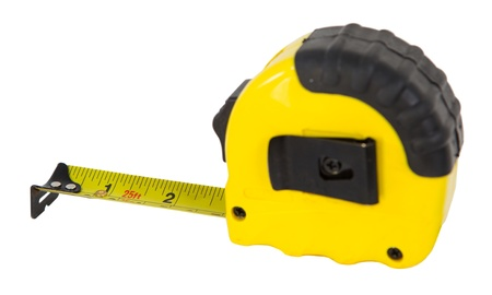 And old roll up measuring tape over white background photo