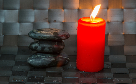 Black zen stones and candle photo