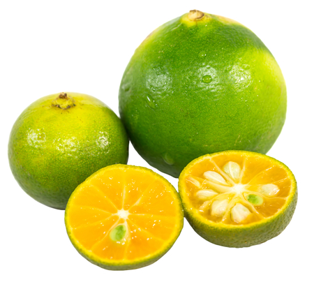 Calamansi and lime over white background Stock Photo