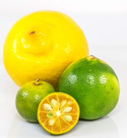Calamansi, lime and lemon over white background Stock Photo