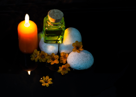 dim light: Dim light spa massage set with zen stones, candle and massage oil