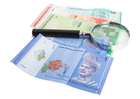 Malaysia bank notes money with magnifying glass photo