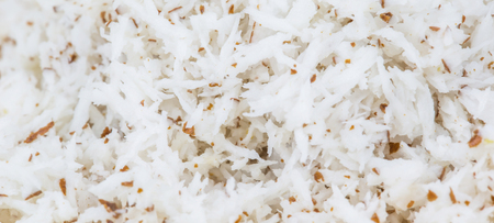 Grated coconut close up view photo