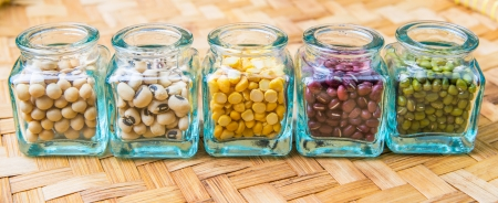Split toor dal, black eyed peas, soya bean, mung bean, azuki bean in a small  bottles  photo