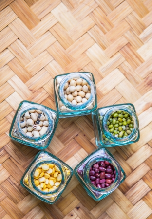 Split toor dal, black eyed peas, soya bean, mung bean, azuki bean in a small  bottles  photo
