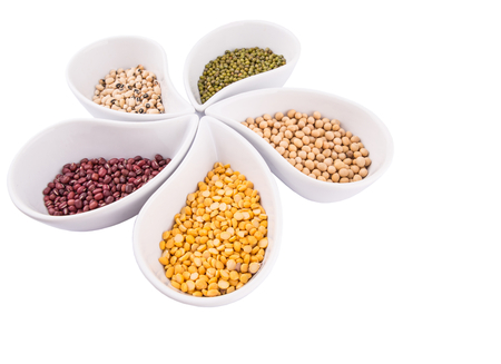 azuki bean: Mix beans and lentils of split toor dal, black eyed peas, soya bean, mung bean, azuki, bean in white ceramic bowls