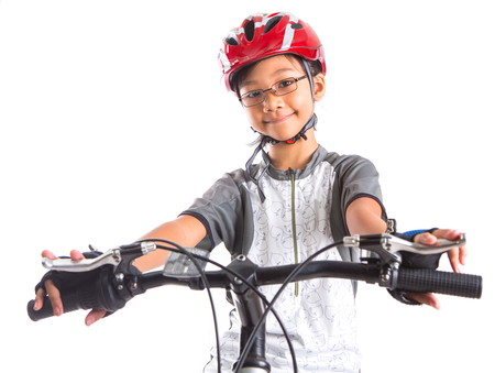 Young Malay Asian girl riding a mountain bike with a white background