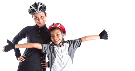 Mother and daughter with cycling attire over white background photo