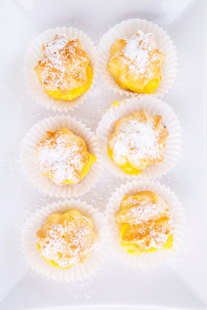 Cream puff over white background photo