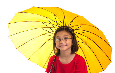 Little Malay Asian girl with umbrella over white background photo