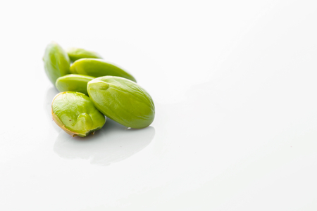 Stink bean or scientific name Parkia Speciosa over white background photo