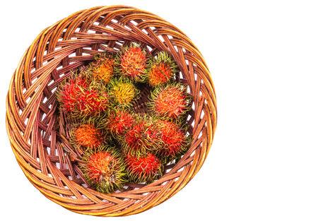 interleaved: A bunch of rambutan in a wicker basket