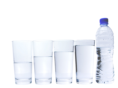 half full: Water filled glasses with mineral water bottle