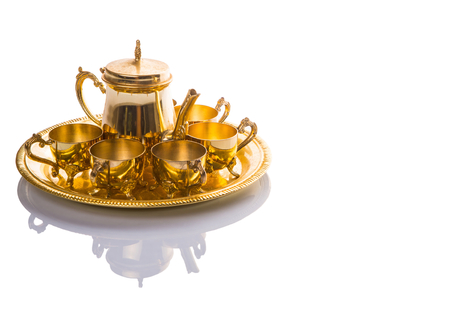 Old Middle Eastern tea set over white background photo