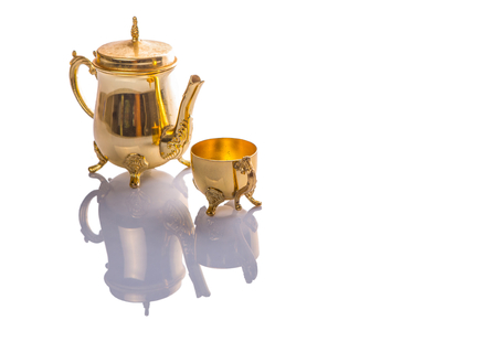 Old antique teapot and cup over white background photo