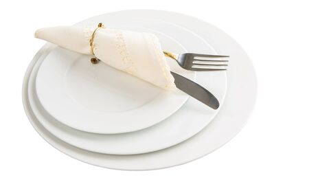 Empty plate with fork, knife and napkin on white background photo
