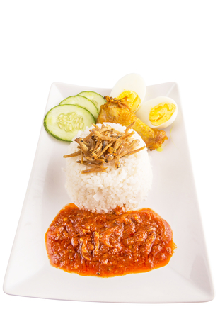 hard boiled: Nasi lemak a traditional and popular Malaysian spicy rice dish  Served with anchovy, chili sauce, cucumber, fried chicken and hard boiled egg