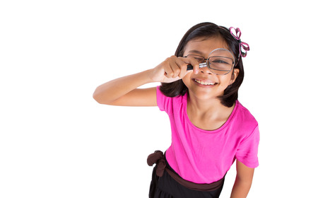 A young girl with a magnifying glass photo
