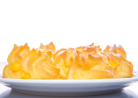 creampuff: Homemade cream puff over white background Stock Photo