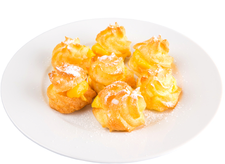 Homemade cream puff over white background photo