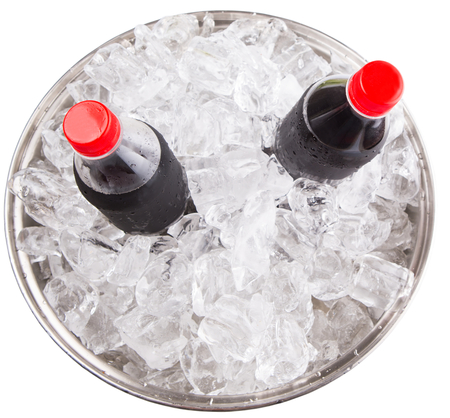 Cola drinks cooled with ice cubes photo