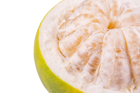citrus maxima: Pomelo or Shaddock fruit exposed flesh over white background