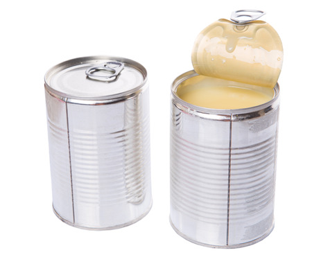 condensed: Condensed milk in tin cans over white background Stock Photo