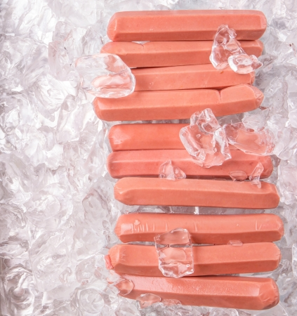 refrigerate: A group of sausages kept fresh on ice cubes