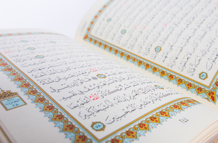 The Holy Quran over white background Stock Photo