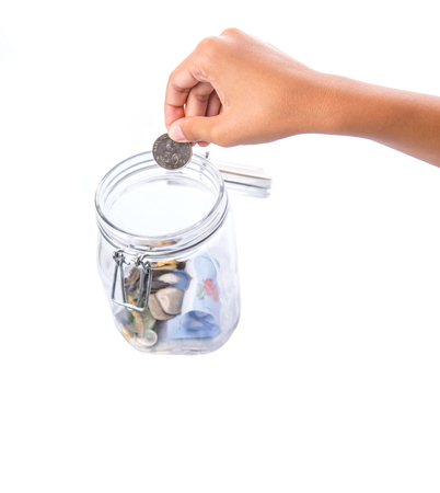 dime: A little girl hands putting coin in a money jar