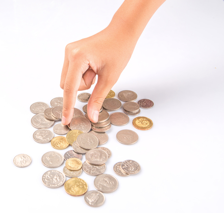 saving tips: Little girl hand picking up coins